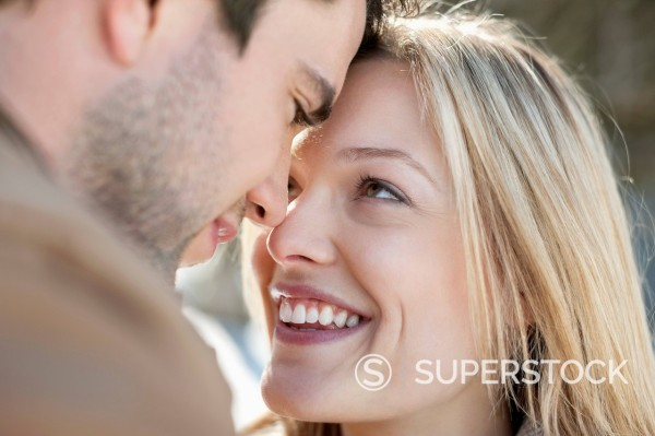 Close up of smiling couple face to face : Stock Photo