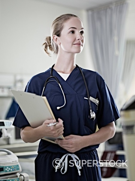 Portrait of confident nurse holding medical record : Stock Photo