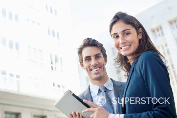 Stock Photo: 1775R-31108 Portrait of smiling businessman and businesswoman with digital tablet