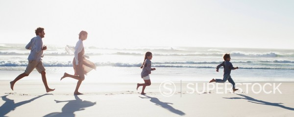 Stock Photo: 1775R-31131 Family running on sunny beach