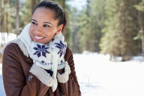 Stock Photo: 1775R-31193 Smiling woman in snowy woods