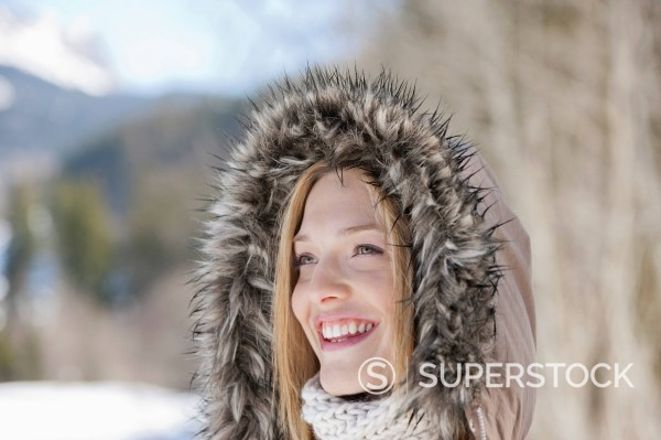 Smiling woman wearing fur hood : Stock Photo
