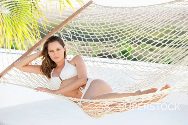 Stock Photo: 1775R-31226 Portrait of woman in bikini laying in hammock