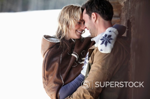 Stock Photo: 1775R-31250 Smiling couple hugging in snow