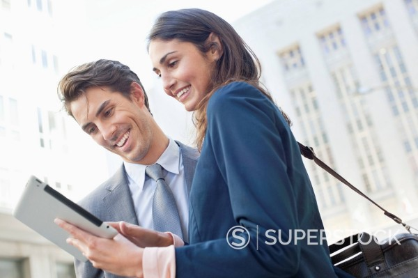 Stock Photo: 1775R-31308 Businessman and businesswoman using digital tablet