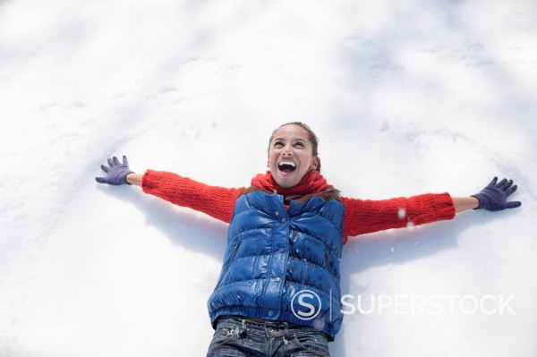 Stock Photo: 1775R-31311 Smiling woman making snow angels