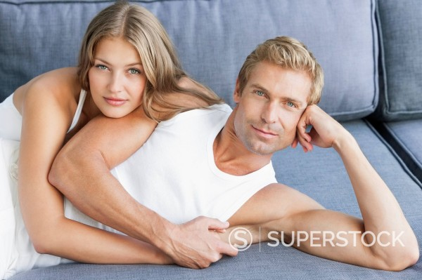 Stock Photo: 1775R-31322 Portrait of smiling couple laying on sofa
