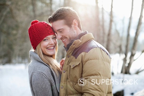 Stock Photo: 1775R-31333 Portrait of smiling couple in snowy woods