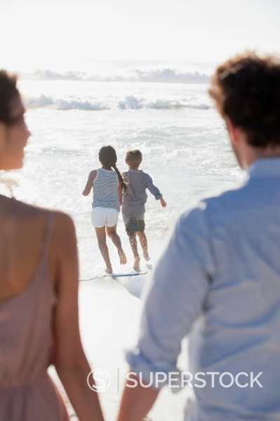 Stock Photo: 1775R-31351 Family on sunny beach
