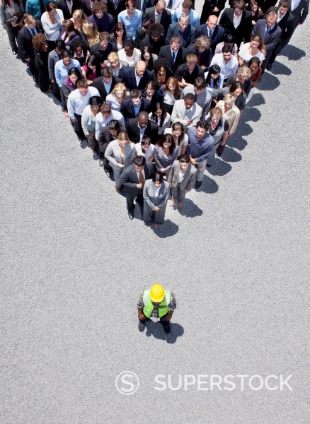 Stock Photo: 1775R-31353 Construction worker at apex of pyramid formed by business people