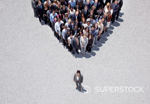 Stock Photo: 1775R-31354 Businesswoman at apex of crowd