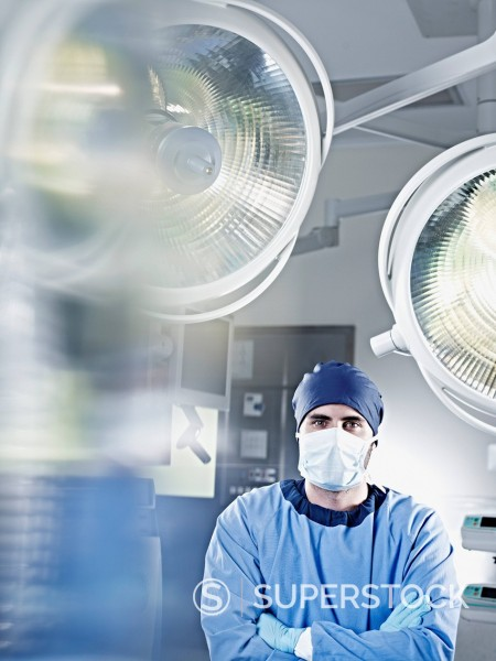Portrait of confident surgeon under surgical lights : Stock Photo