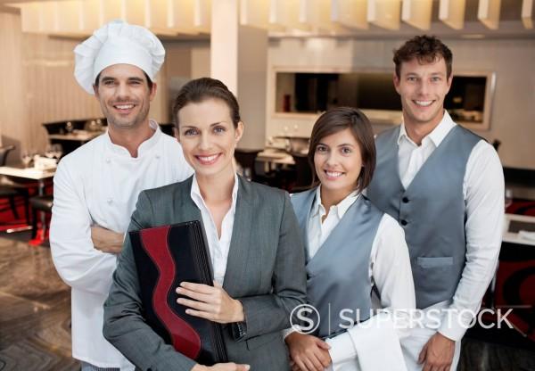 Portrait of smiling restaurant employees : Stock Photo