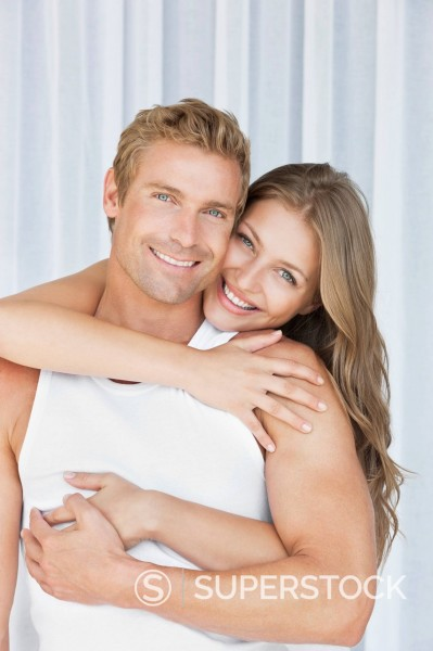 Stock Photo: 1775R-31392 Portrait of smiling couple hugging