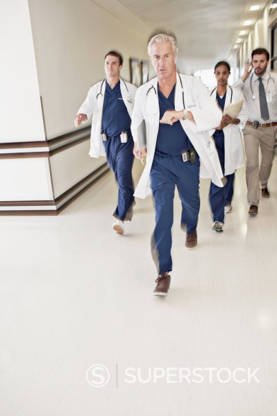 Stock Photo: 1775R-31419 Doctors rushing down hospital corridor
