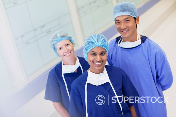Stock Photo: 1775R-31420 Portrait of smiling surgeon and nurses in hospital corridor
