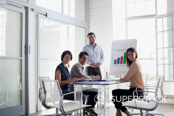 Stock Photo: 1775R-31427 Portrait of confident business people meeting in conference room