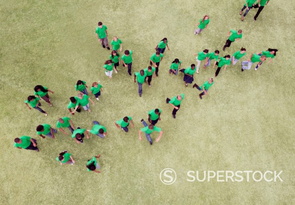 Stock Photo: 1775R-31450 People in green t_shirts walking in field