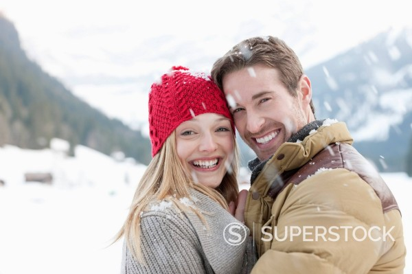 Stock Photo: 1775R-31460 Portrait of smiling couple hugging in snow