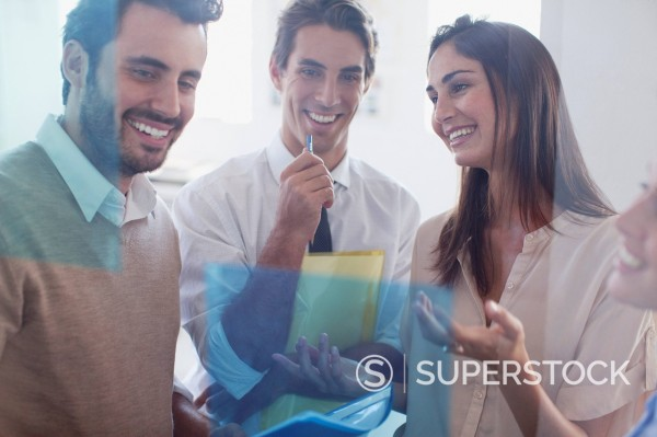 Smiling business people working together in office : Stock Photo
