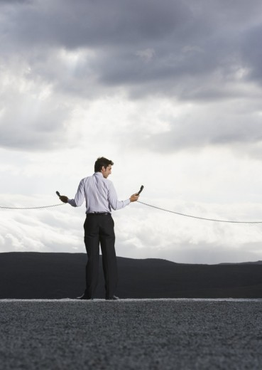 Man outdoors with telephone receiver : Stock Photo
