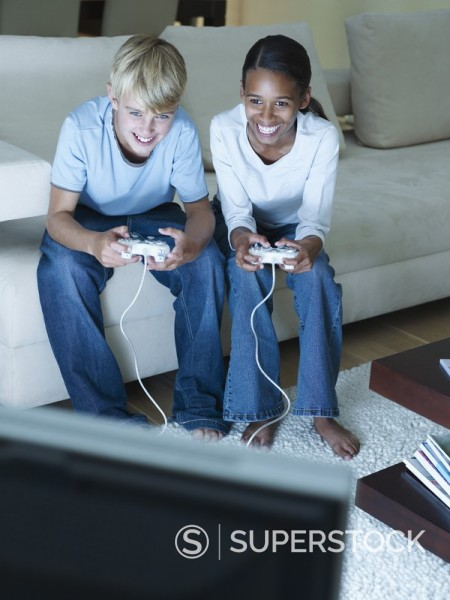 Stock Photo: 1775R-3792 Two young kids playing a video game