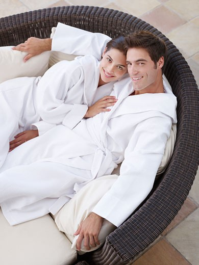 Stock Photo: 1775R-3832 A couple relaxing in bathrobes