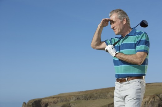 Stock Photo: 1775R-4028 man golfing trying to see where his drive went
