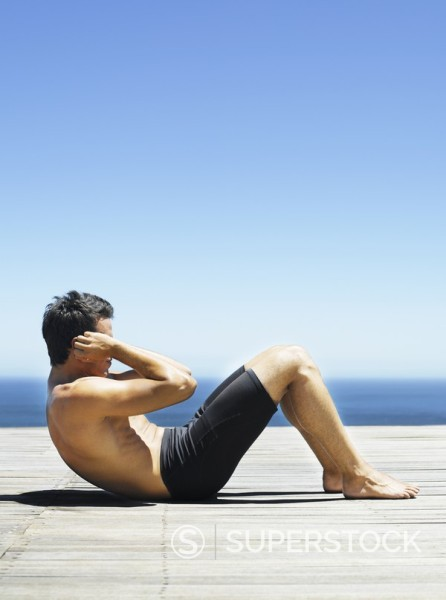 Stock Photo: 1775R-4158 Man doing sit-ups