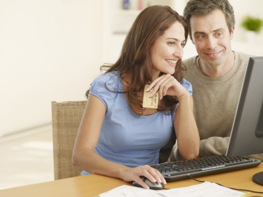 Stock Photo: 1775R-4591 Couple shopping online with a credit card