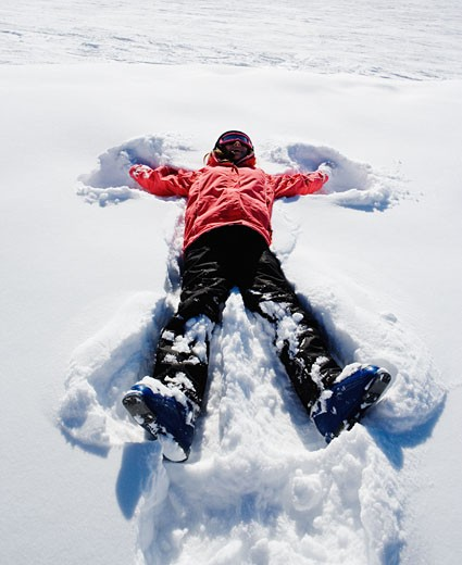 Stock Photo: 1775R-4756 A girl making a snow angel