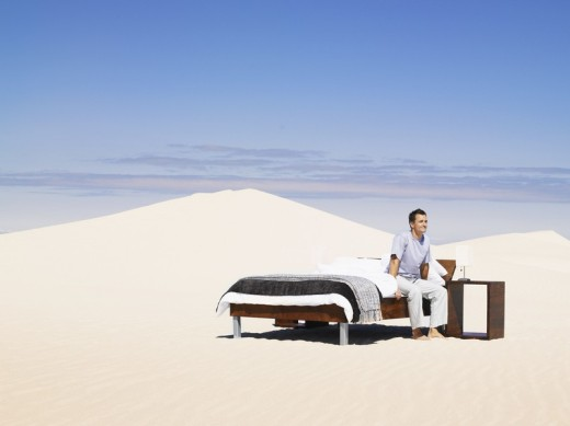 Stock Photo: 1775R-4924 A man sitting in a bed outdoors