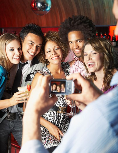 Friends hanging out at a club taking pictures : Stock Photo