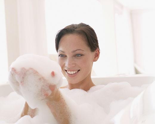 A woman in a bathtub : Stock Photo