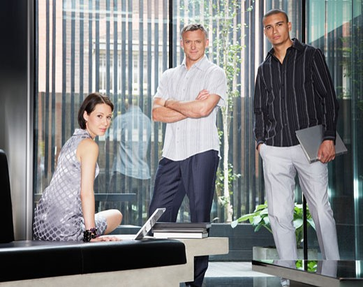 Three businesspeople in an office : Stock Photo