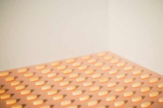 Pills lined up in rows : Stock Photo