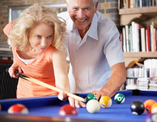 Stock Photo: 1775R-7308 Couple playing pool
