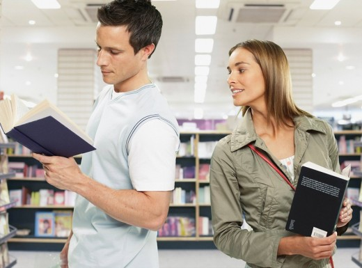 Couple looking at books in store : Stock Photo