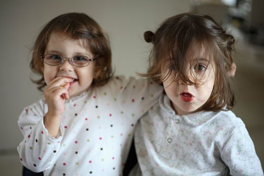 Two young girls indoors : Stock Photo
