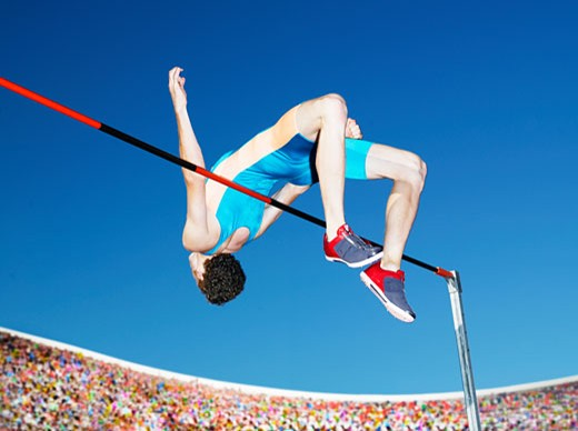 Stock Photo: 1775R-8222 Athlete high jumping in an arena