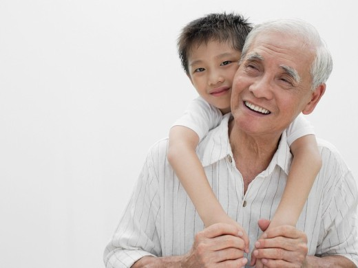 Stock Photo: 1775R-8683 Young boy with arms around man indoors