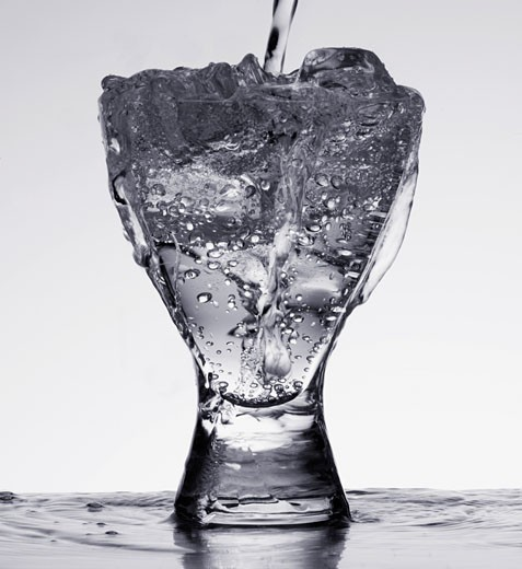 Stock Photo: 1775R-9135 Beverage with ice being poured indoors
