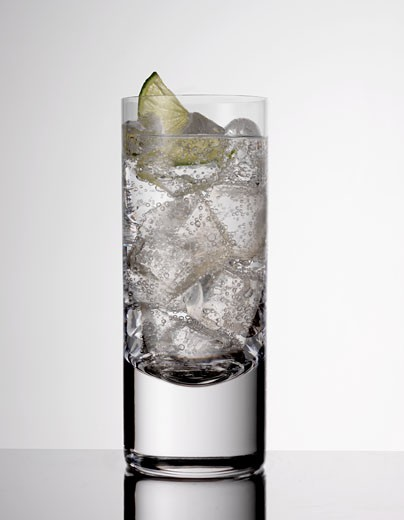 Beverage indoors with lime slice and ice : Stock Photo