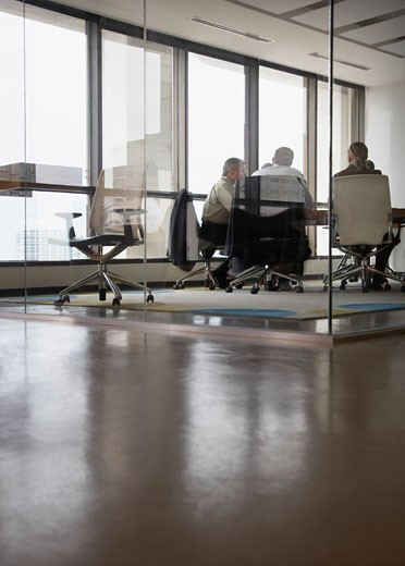 Three businesspeople in boardroom : Stock Photo