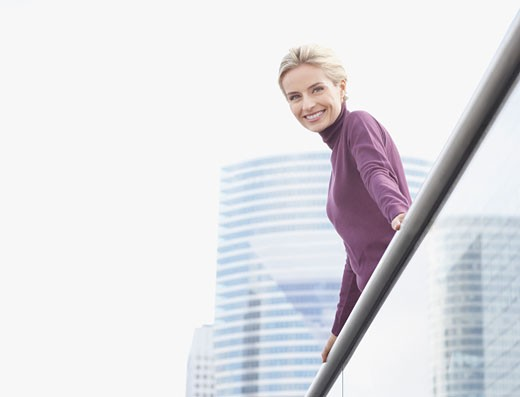 Stock Photo: 1775R-9310 Woman standing on balcony outdoors