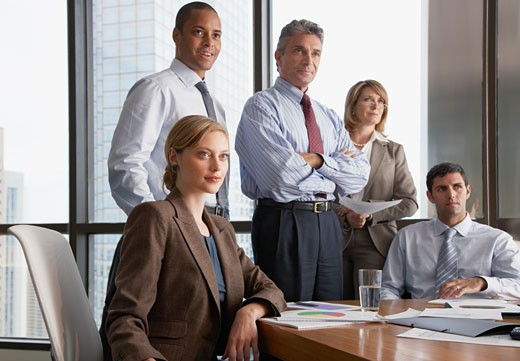 Stock Photo: 1775R-9547 Five businesspeople in boardroom by large windows