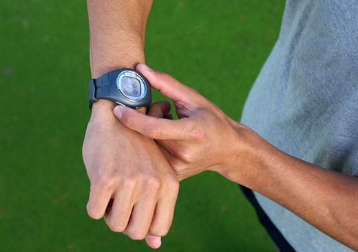 Man´s hands using wristwatch outdoors : Stock Photo