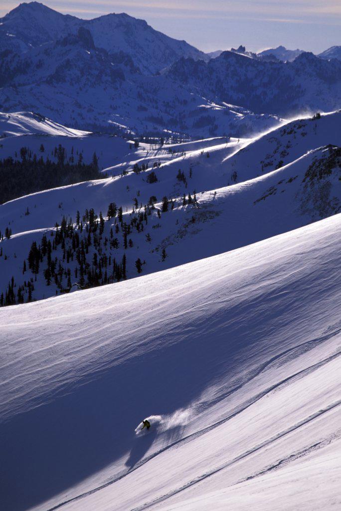 A man backcountry skiing on a bluebird powder day : Stock Photo