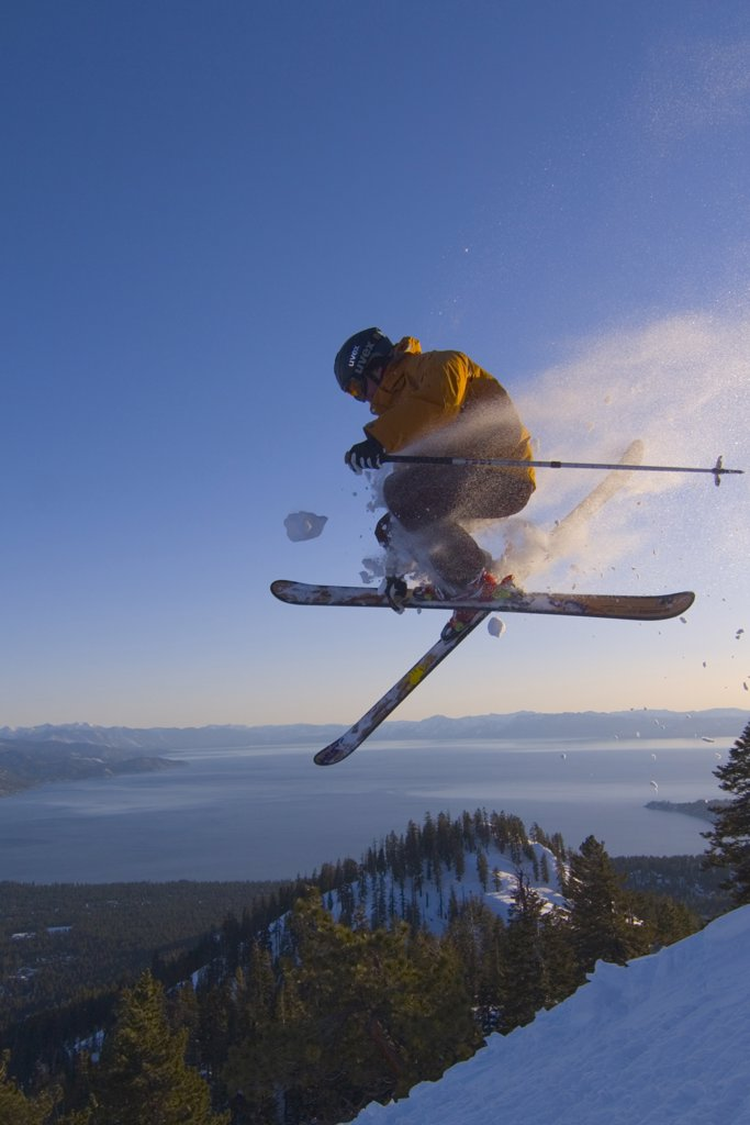 Stock Photo: 1778-11468 A man jumping on skis above Lake Tahoe in California