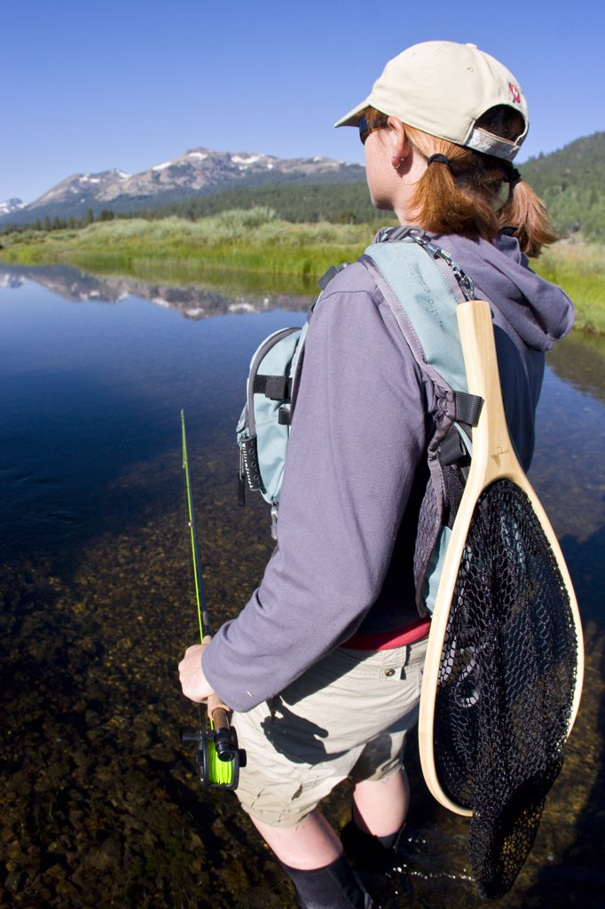 Stock Photo: 1778-11951 Young woman fly fishing the West Fork of the Carson River in Hope Valley Lake Tahoe, California
